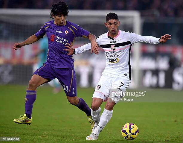 Achraf Lazaar of Palermo and Matias Fernandez of Fiorentina compete for the ball during the Serie A match between ACF Fiorentina and US Citta di...