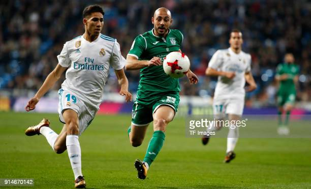 Achraf of Real Madrid and Amrabat of Leganes battle for the ball during the Copa del Rey quarter final match between Real Madrid and Leganes at the...