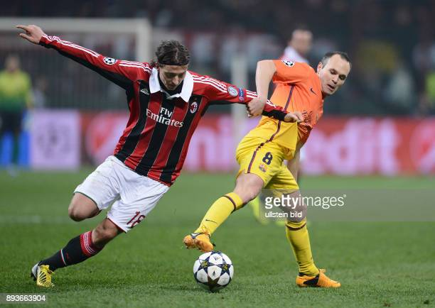 AchtelfinalHinspiel Saison 2012/2013 FUSSBALL CHAMPIONS AC Mailand FC Barcelona Andres Iniesta gegen Riccardo Montolivo
