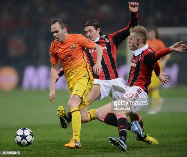 AchtelfinalHinspiel Saison 2012/2013 FUSSBALL CHAMPIONS AC Mailand FC Barcelona Andres Iniesta gegen Riccardo Montolivo und Ignazio Abate