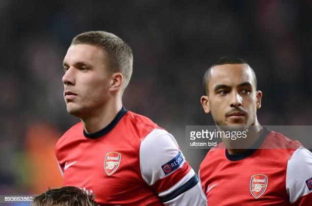 AchtelfinalHinspiel Saison 2012/2013 FUSSBALL CHAMPIONS FC Arsenal London FC Bayern Muenchen Lukas Podolski und Theo Walcott