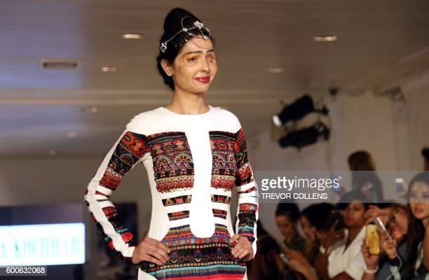 Acid attack survivor Reshma Bano of India walks the runway during the FTL Moda presentation at New York Fashion Week in New York on September 8 2016...