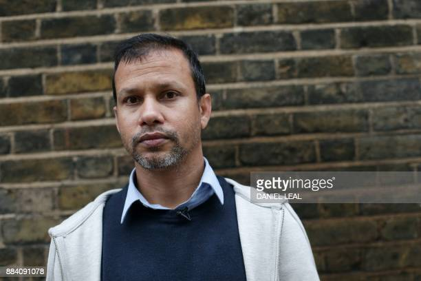Acid attack victim Jabed Hussain poses for a picture at the location where the attack took place in east London England on October 19 2017 Delivery...