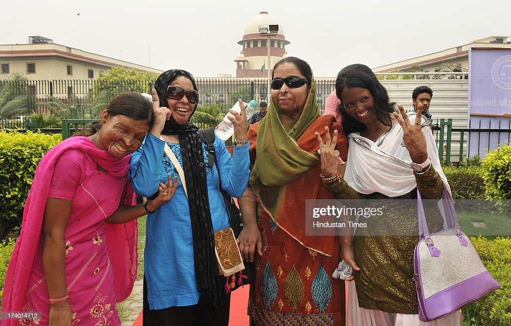 Acid attack victim Laxmi (R) with other victims at Supreme Court after hearing on plea filed by her on the regulation of sale of the chemicals at the retail level on July 18, 2013 in New Delhi, India. Laxmi was attacked with acid by three men near Tughlaq road in New Delhi as she had refused to marry one of them. The Supreme Court directed States and Union Territories to frame rules to regulate sale of acids and other corrosive substances within three months and make acid attack a non-bailable offence. The court also directed that acid attack victims shall be paid a compensation of at least Rs. 3 lakh by the State Government concerned as an after-care and rehabilitation cost for such victims.