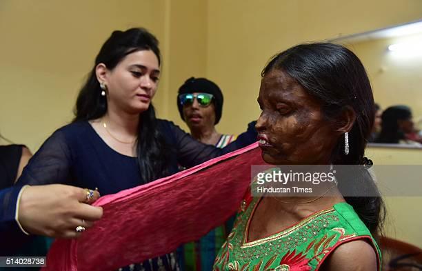 Acid attack victims getting ready to take part in a fashion show organised by Prerna NGO to mark the International Women's Day on March 6 2016 in...