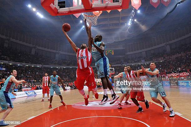 Acie Law #5 of Olympiacos Piraeus competes with Nathan Jawai #32 of FC Barcelona Regal during the 20122013 Turkish Airlines Euroleague Top 16 Date 10...