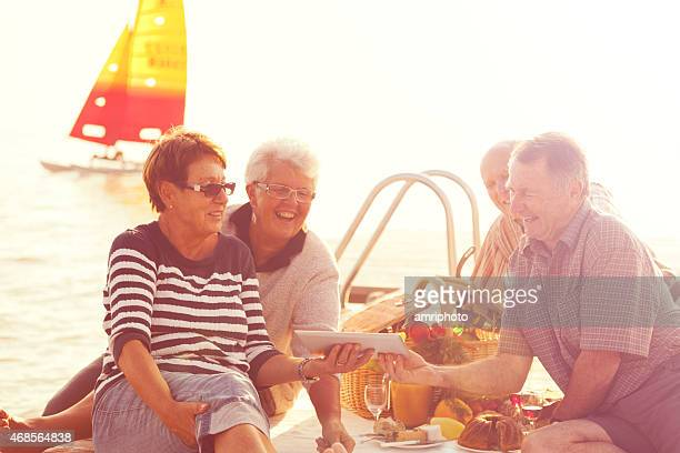acitve and modern happy seniors with tablet, retro style