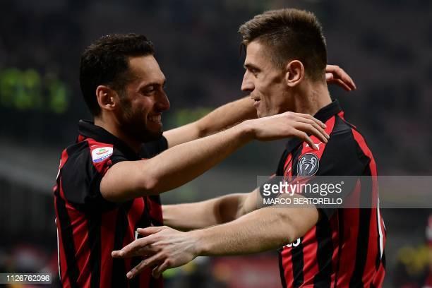 ACMilan's forward Krzysztof Piatek from Poland celebrates after scoring during the Italian Serie A football match AC Milan vs Empoli on February 22...