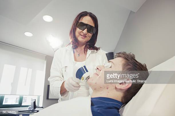 acne scar removal treatment - scar stock photos and pictures