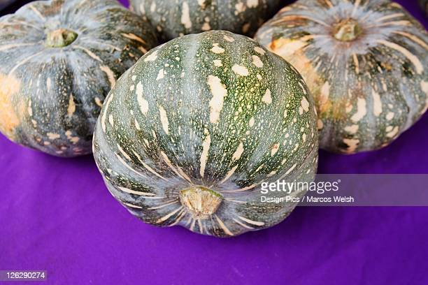 acorn squash sitting on a purple surface