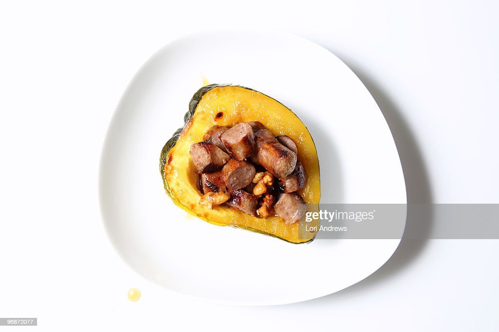 Acorn squash stuffed with sausage : Stock-Foto