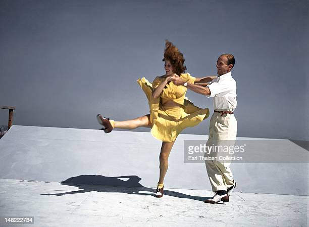 Acors and dancers Rita Hayworth and Fred Astaire rehearse on a roof top at Columbia Pictures for a scene from their film 'You Were Never Lovelier' in...