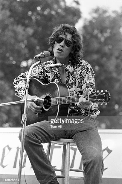 Acoustic blues player John Paul Hammond performs at the University of Georgia's Legion Field on June 26, 1972 in Athens, Georgia, United States.