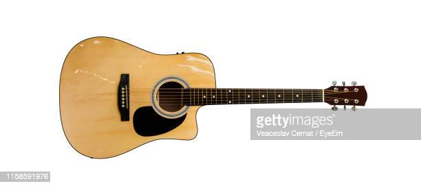 acoustic guitar against white background - gitarre stock-fotos und bilder