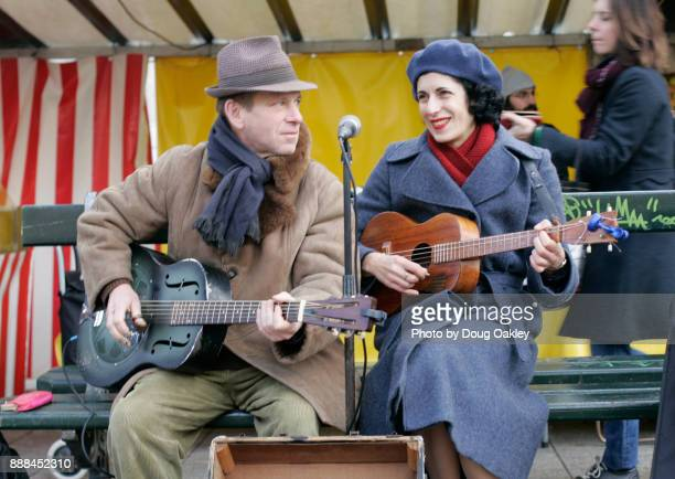 acoustic guitar duo perform at marche bastille open air market in paris - bastille band stock pictures, royalty-free photos & images