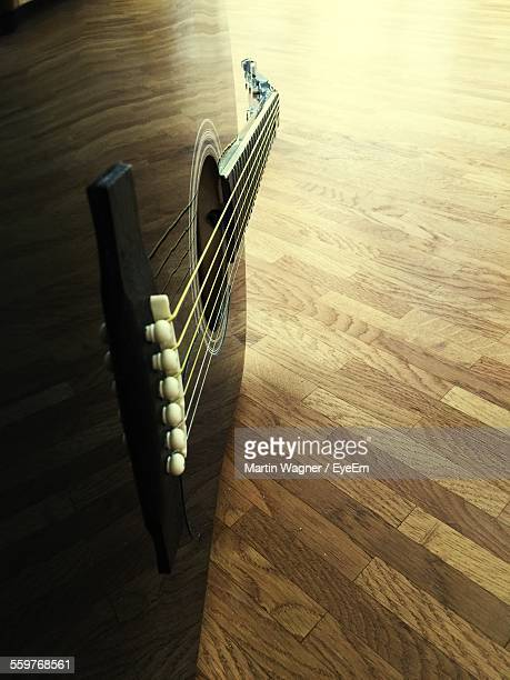 acoustic guitar on parquet floor - martin guitar stock photos and pictures
