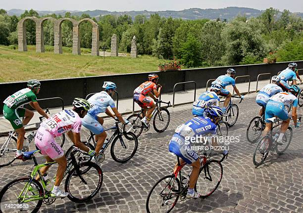 Raiders passes near an ancient Roman bridge in Acqui Terme during the eleventh stage of the Giro d'Italia cycling race 198 km leg from Serravalle...
