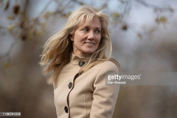 Acress Joely Richardson rides on top of a carriage as members of the Household Cavalry Mounted Regiment take part in their annual Inspection in Hyde...
