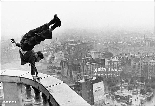Acrobat Hans Prignitz performs a handstand on St Michael's Church in Hamburg Germany 1948