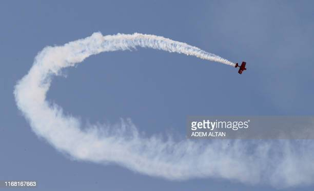 Acrobatic biplane performs during the Sivrihisar Airshow in Sivrihisar district of Eskisehir on September 14 2019