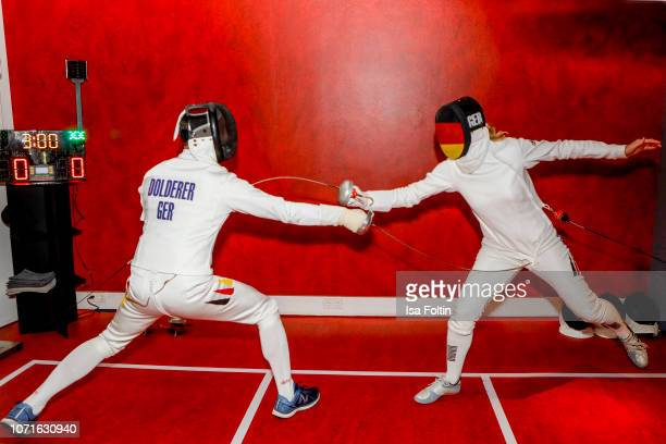Acrobatic flight star Matthias Dolderer and fencing oplympic gold medalist Britta Heidemann during the event 'FechtOlympiasiegerin fliegt mit Daimler...