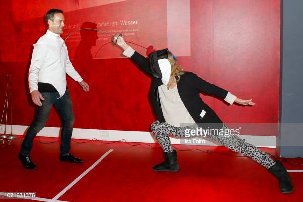 Acrobatic flight star Matthias Dolderer and German fencing olympic gold medalist Britta Heidemann during the event 'FechtOlympiasiegerin fliegt mit...