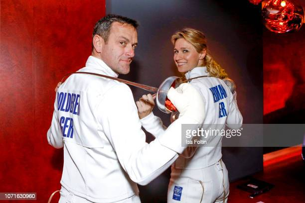 Acrobatic flight star Matthias Dolderer and German fencing oplympic gold medalist Britta Heidemann during the event 'FechtOlympiasiegerin fliegt mit...