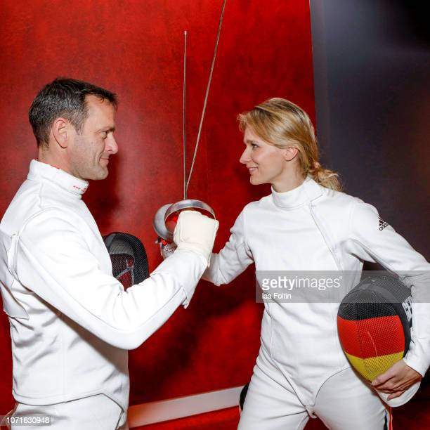 Acrobatic flight star matthias Dolderer and German presenter Verena Wriedt and fencing oplympic gold medalist Britta Heidemann during the event...