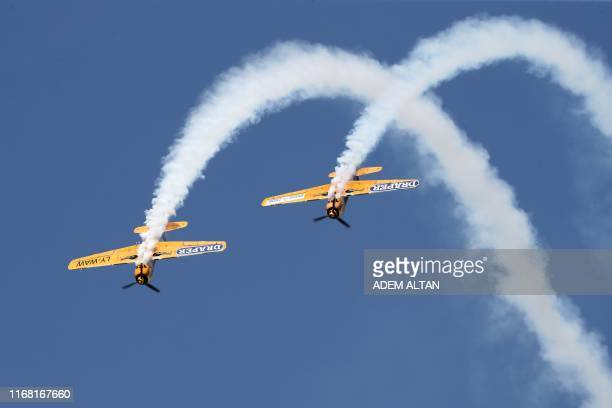 Acrobatic planes perform a flying display during the Sivrihisar airshow in Sivrihisar district of Eskisehir on September 14 2019