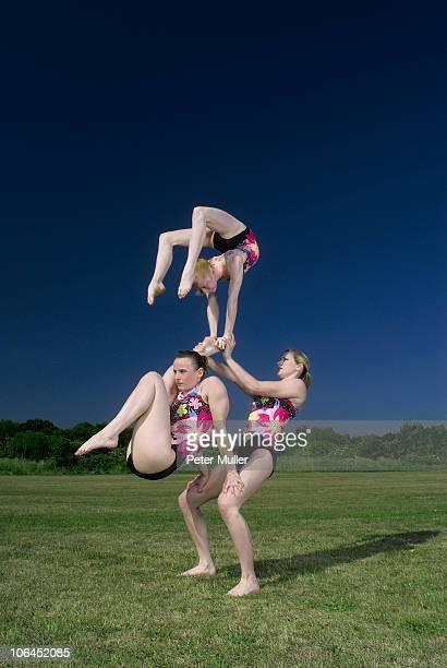 Acrobatic troop performing moves