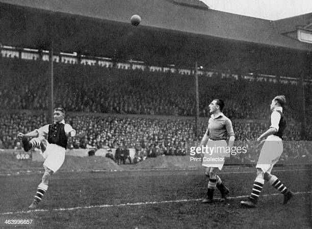 Acrobatics in a Arsenal v Chelsea match at Stamford Bridge London c1933c1938 Arsenal captain Eddie Hapgood clears the ball watched by Chelsea's...