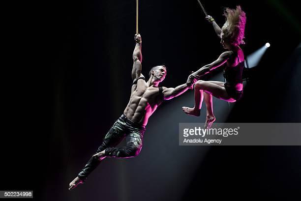 Acrobats Alex and Nastya Mischenko of Ukraine perform the Duo Strap show during the media pass of the Cirque Adrenaline show on 22 December 2015 in...