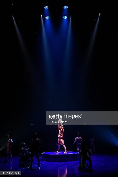 Acrobats and artists of the Canadian entertainment company Cirque du Soleil perform during a rehearsal of the Messi10 show based on the career of...