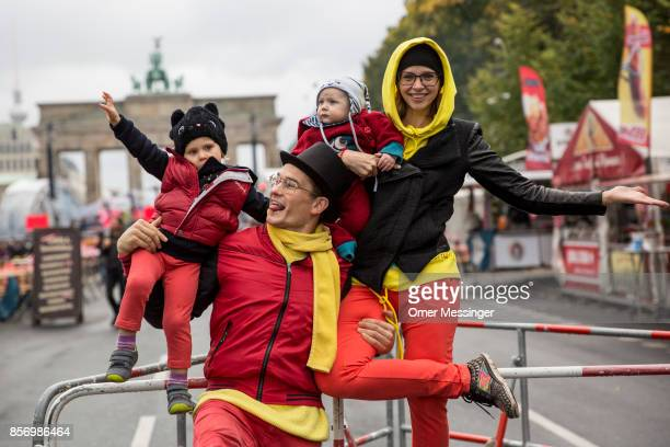 Acrobats Berlinjohn And Berlintina dressed in ttthe colors of the German national flag are seen holding their children Jet and his sister Junia at an...