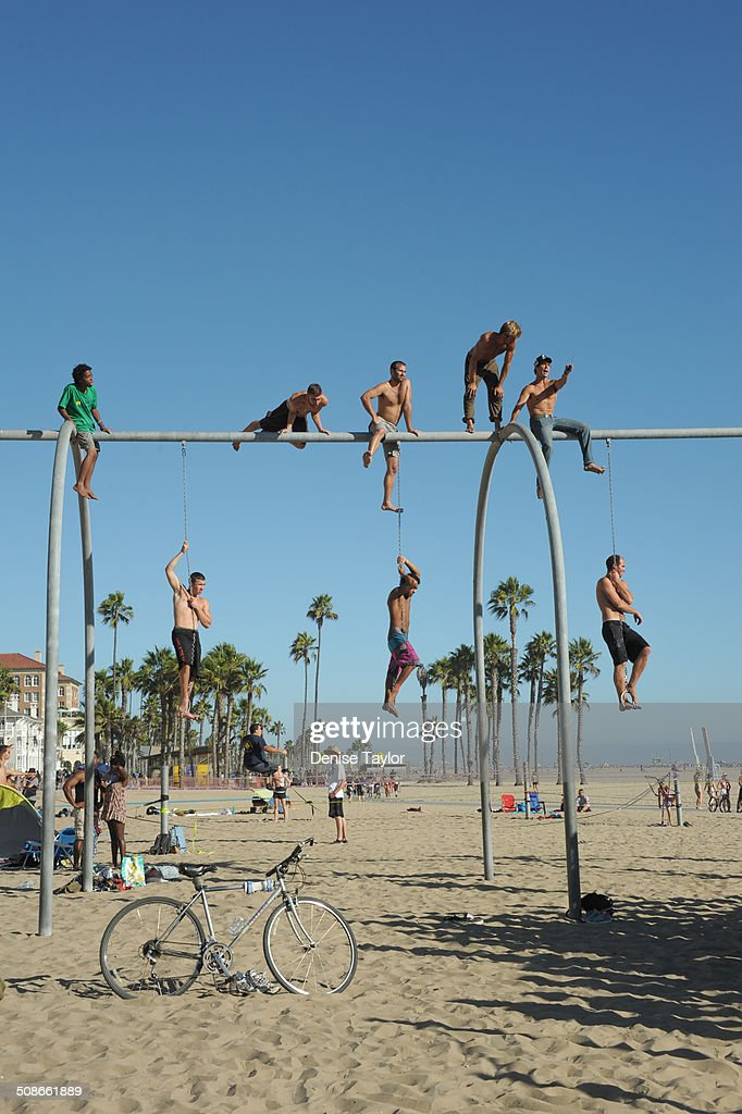Acrobats climb on the rings at Santa Monica's muscle beach. August 17 2014