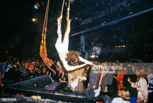 Acrobats descend from the rafters as part of a New Year's Eve party performance at Studio 54 New York New York January 1 1978