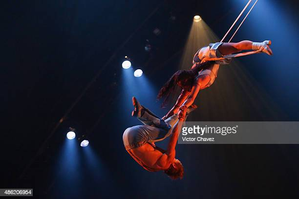 Acrobats from Cirque Du Soleil perform in the show 'Corteo' at Carpa Santa Fe on September 1 2015 in Mexico City Mexico