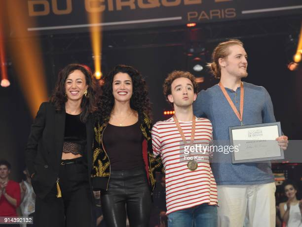 Acrobats Marius and Cesar receive a prize from actresses Janane Boudili and Sabrina Ouazani attend the 39th 'Festival Mondial Du Cirque de Demain'...