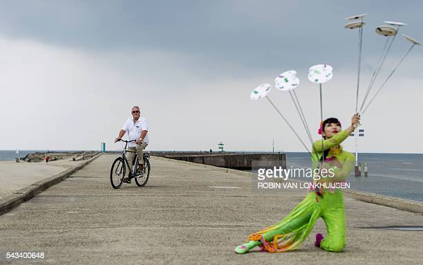 TOPSHOT Acrobats of the China national Acrobatic Troupe take part in a presentation at Scheveningen harbour the Netherlands on June 28 2016...