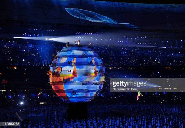 Acrobats perform on a large sphere in the National Stadium during the opening ceremony on Friday August 8 to kick off the Games of the XXIX Olympiad...