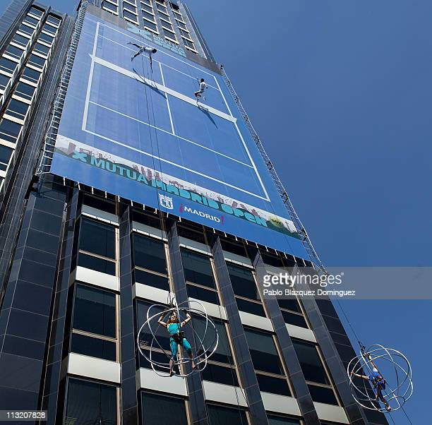 Acrobats play a vertical Tennis match at the Mutua Madrilena building at Castellana Street to present the Madrid Open Tennis 2011 on April 27 2011 in...