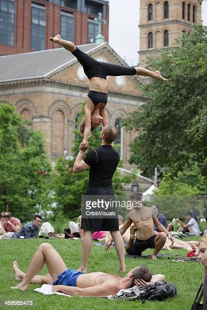 Acrobats prepare a show in Washington Square Park NYC