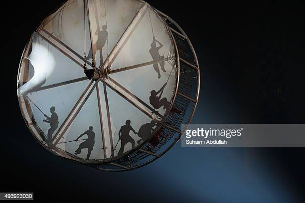 Acrobats put up a performance choreographed by Spanish performance troupe La Fura dels Baus the Hamster Wheel act during the Singapore River Festival...