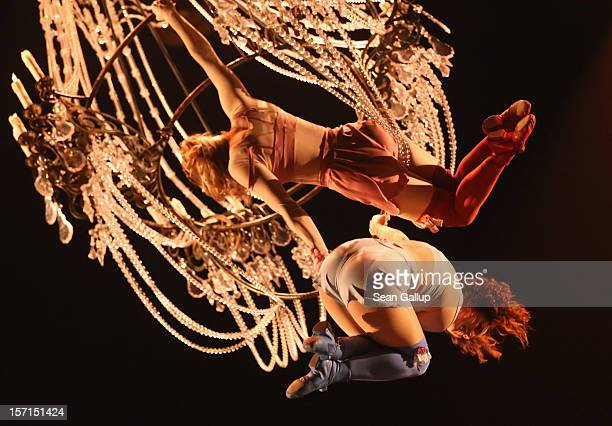 Acrobats swing on a chandelier during the Corteo production at the Cirque Du Soleil circus dress rehearsal on November 28 2012 in Berlin Germany...