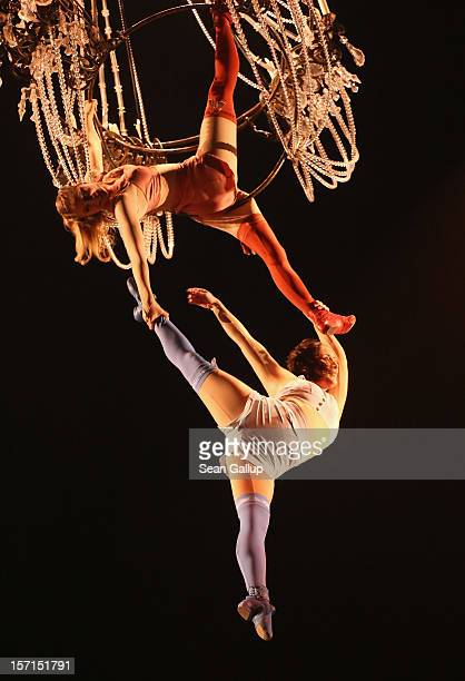Acrobats Swing On A Chandelier During The Corteo Production At Cirque Du Soleil Circus Dress