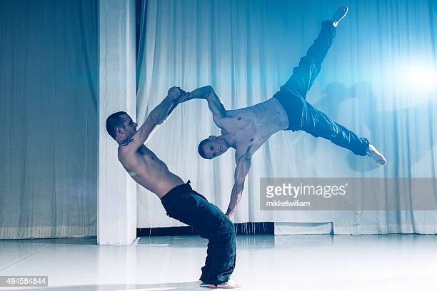 Acrobats use skills and muscles to perfom