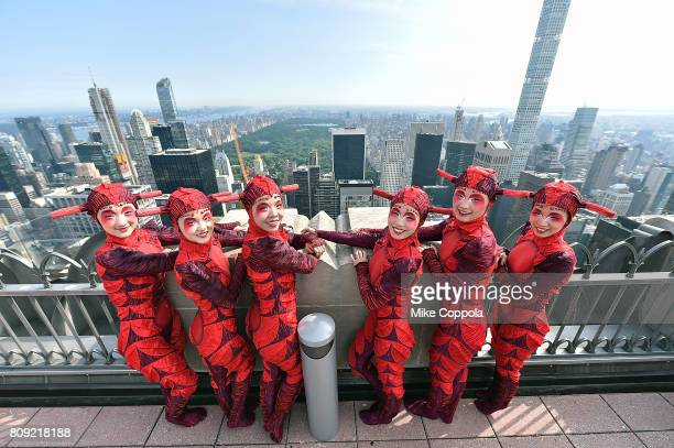Acrobats/performers of Cirque Du Soleil OVO visit The Top Of The Rock at Top of the Rock Observation Deck at Rockefeller Center on July 5 2017 in New...