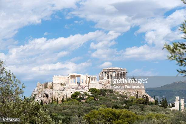 acropolis of athens with clouds. - ancient greece photos stock pictures, royalty-free photos & images