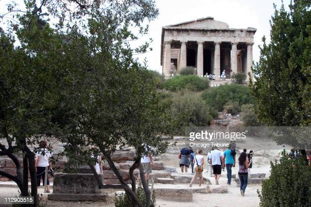 Across the Ancient Agora from the Acropolis in Athens Greece the dainty Temple of Hephaestus is built of Pentellic marble the same glinting white...