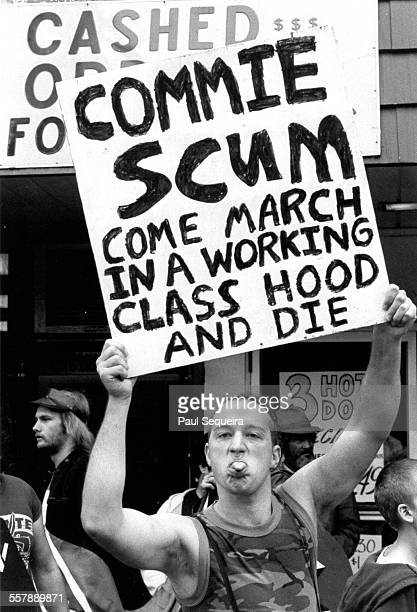 Across the street from Harry S Truman College an unidentified neoNazi sticks his tongue out as he holds a sign during a counter protest at an...